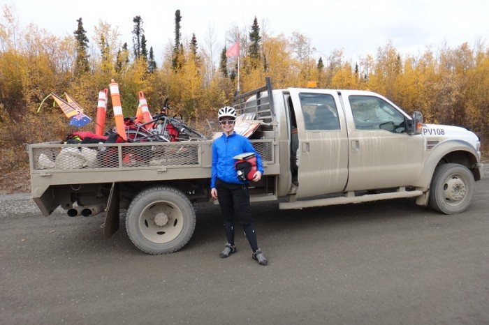 "Canada 28 - Jo and the ""pilot"" truck, which carried us 8km through the construction zone near Beaver Creek"