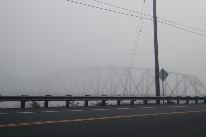 Astoria, Oregon - The Astoria Bridge covered in fog