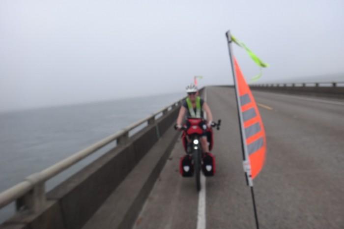 Astoria, Oregon - Jo cycling along the Astoria Bridge