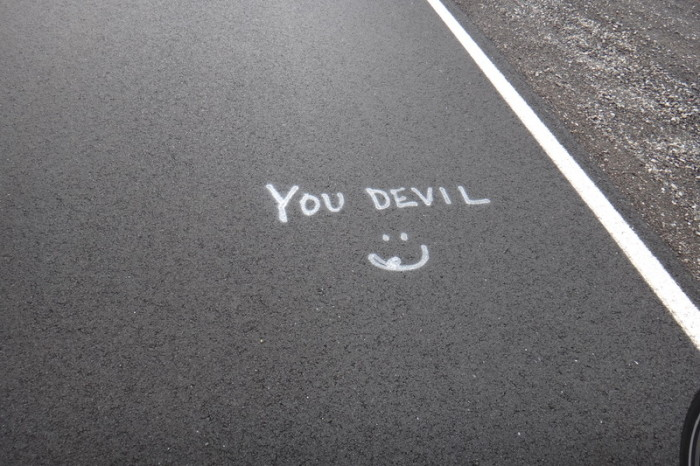 Portland to San Francisco - Marking on the road at the end of Seven Devils Road