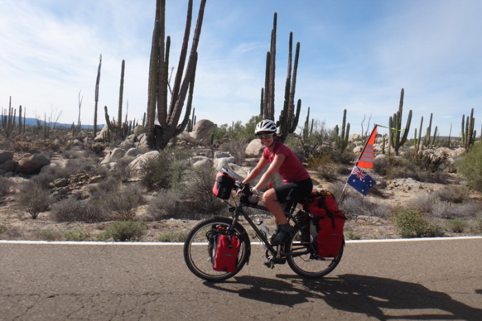 Baja California - Jo cycling through the Cataviña Boulder Field on Day 2 of our Central Desert crossing