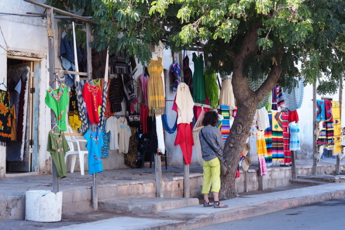 Baja California - Colourful clothes store, Mulege