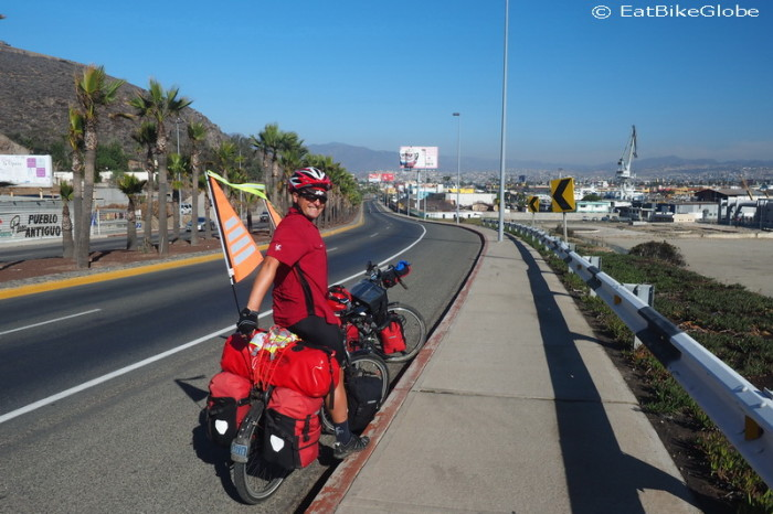 Baja California - David cycling into Ensenada