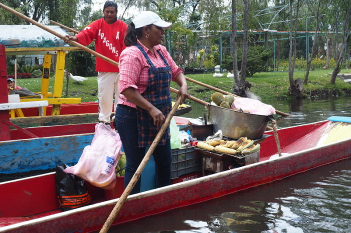 Mexico City - You can buy all kinds of food and drinks while floating along the canals! This canoe was selling freshly roasted sweetcorn smile emoticon — in Xochimilco