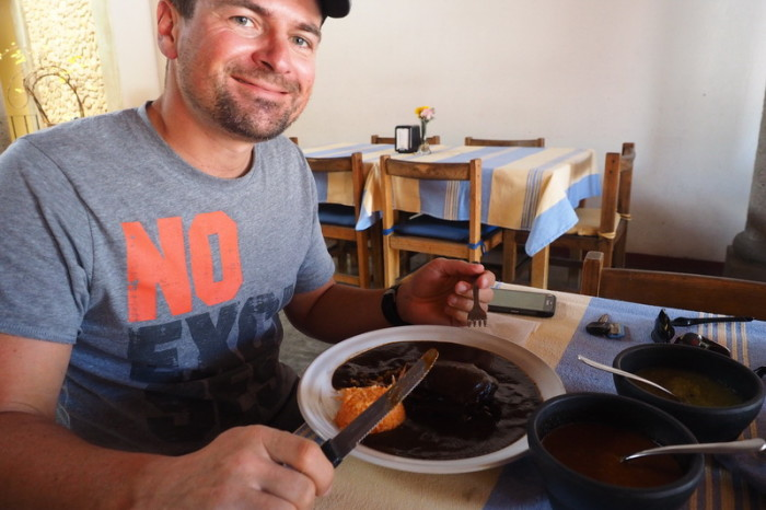 Day trip to the Valle de Tlacolula  - David trying black mole chicken at Restaurante Doña Chica, Mitla