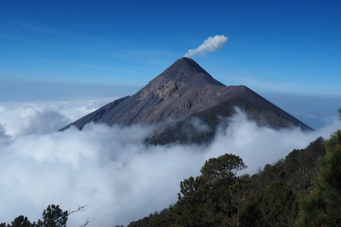 Guatemala - Stunning Volcano de Fuego enveloped  by clouds