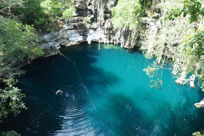Mexican Road Trip - David swimming in the magical Yokdzonot Cenote, Yokdzonot, Yucatan, Mexico