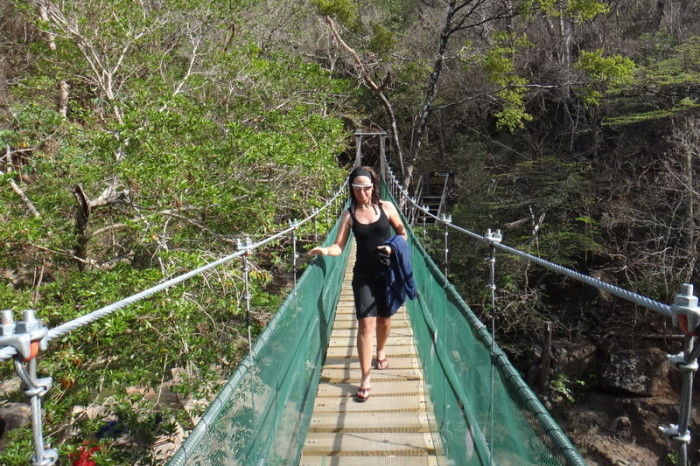 Costa Rica - Walking across the suspension bride across Rio Negro