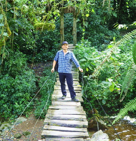 Colombia - David crossing one of the numerous bridges! Valley de Cocora, near Salento