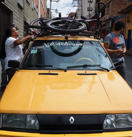 Colombia - Transporting our bikes from our Hostel to the bike shop in Medellin!