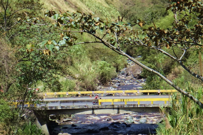 Colombia - Jo crossing a bridge on the way to El Bordo