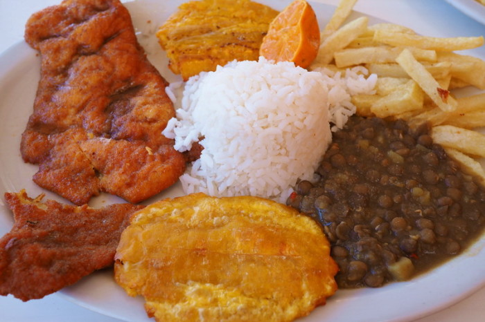 Colombia - A typical Colombian lunch - chicken, 3 types of carbs (rice, fries and platano) and lentils!