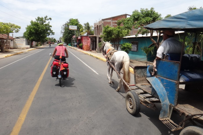 Nicaragua - Overtaking horse and carts on the way to the port at San Jorge, Nicaragua