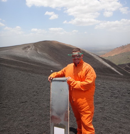 Nicaragua - David ready to volcano board down Cerro Negro Volcano - the protective suit makes him look like a sumo!