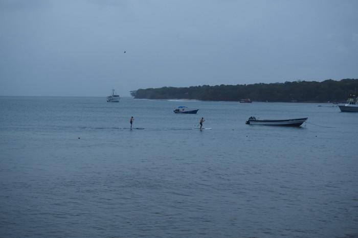 Nicaragua - David and Simon having a stand up paddle board race, Little Corn Island, Nicaragua
