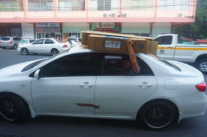 Panama - Transporting our bike boxes - no roof rack or straps - they were held on by hand only!
