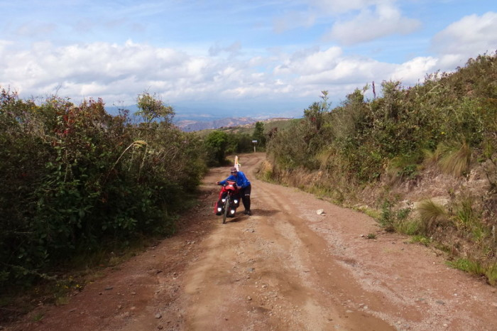 Ecuador - Jo pushing her bike up the hill from Hacienda El Hato to the highway!