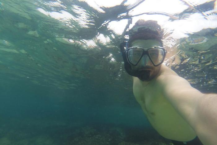 Galapagos - David snorkeling off Santiago Island