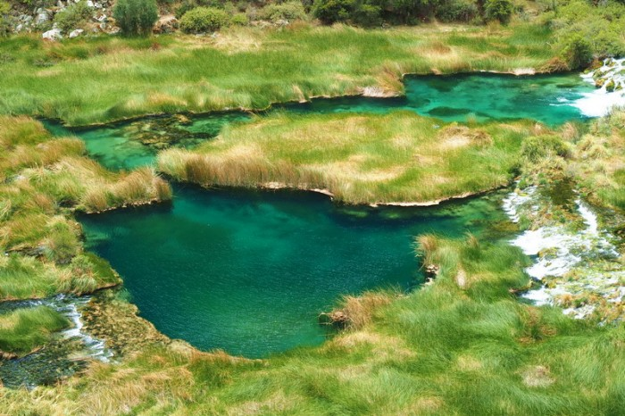 Peru -  Breathtaking Huallhua - the water was really that colour and so clear! — at Nor Yauyos-Cochas Landscape Reserve