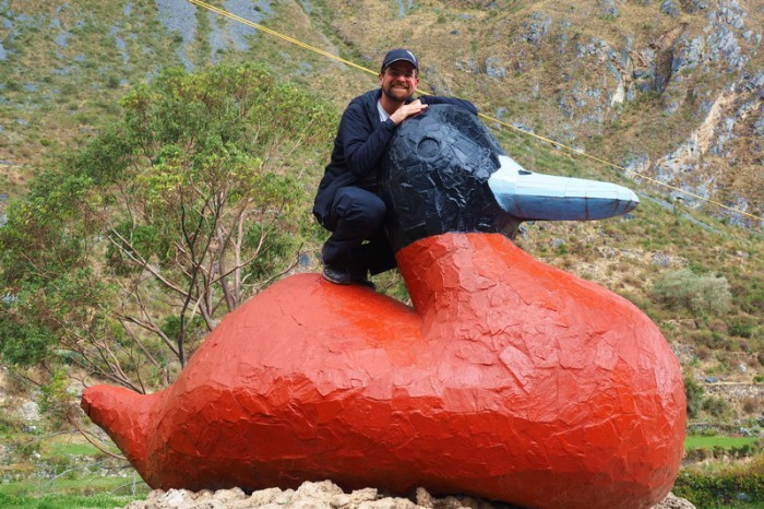 Peru -  David couldn't resist a photo with the Giant Duck at Huancaya!