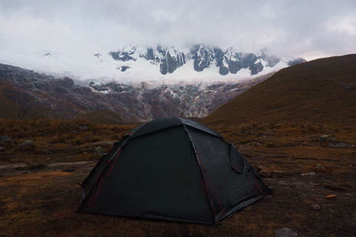 Santa Cruz Trek - Our campsite with Mount Taulliraju in the background covered in clouds