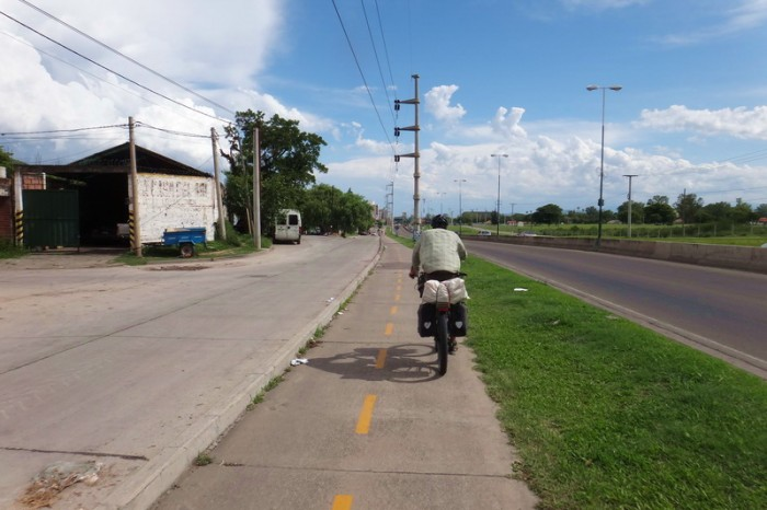 Argentina - Vince cycling into Salta ... we were happy to find a bike path!