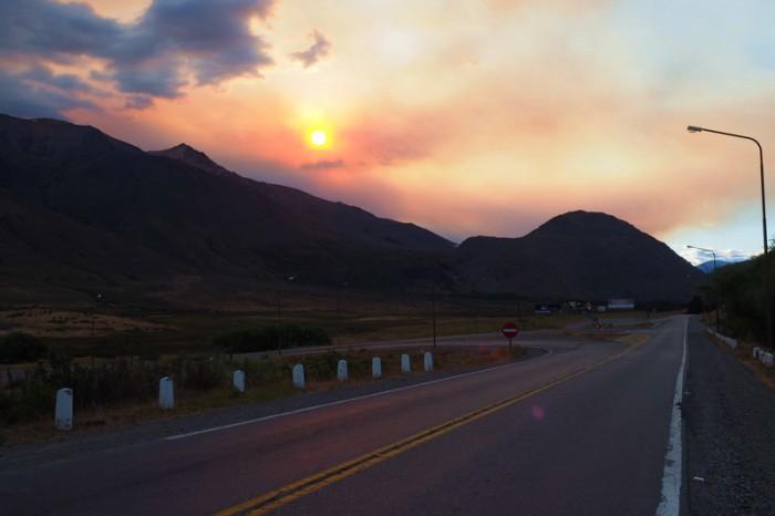 Argentina - Cycling into Esquel, the sky was ablaze with smokey colour