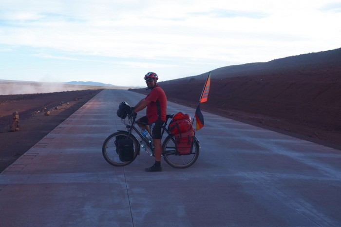 Bolivia - The kind workmen let us cycle on the new road to get away from the dirt road and the dust! It was wonderful!