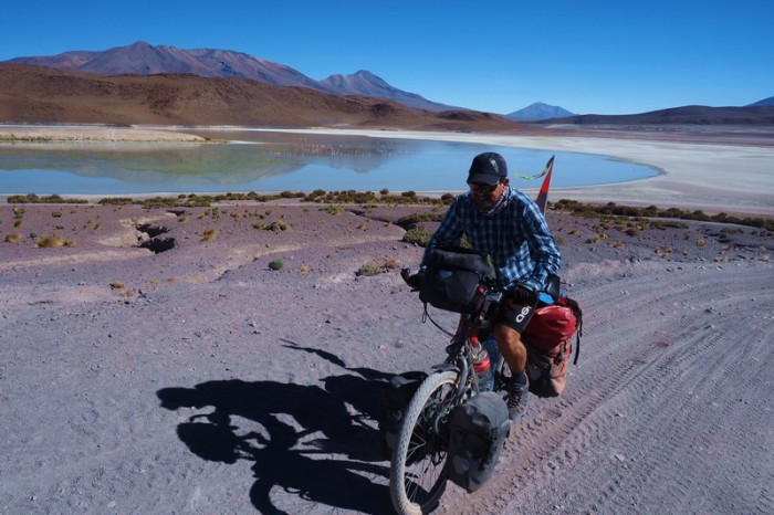 Bolivia - Day 3 of the Laguna Route: David cycling alongside Laguna Honda