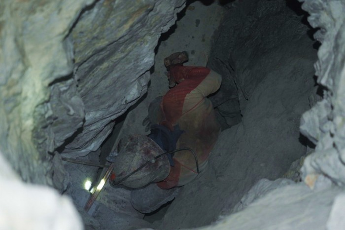 Bolivia - A miner working by hand in a mine shaft, Cerro Rico Mine, Potosi
